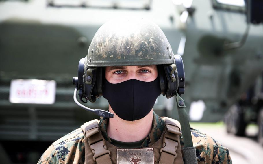 Marine Cpl. Tyler Wyatt wears a mask to protect against the coronavirus during exercise Caged Hydra at Camp Hansen, Okinawa, May 20, 2020.