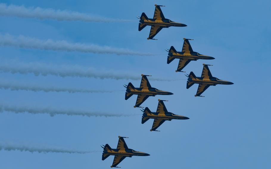 The South Korean air force's aerobatic team, the Black Eagles, conduct a flyover during a Korean War memorial service at Osan Jukmiryeong Peace Park in Osan, South Korea, Sunday, July 5, 2020.