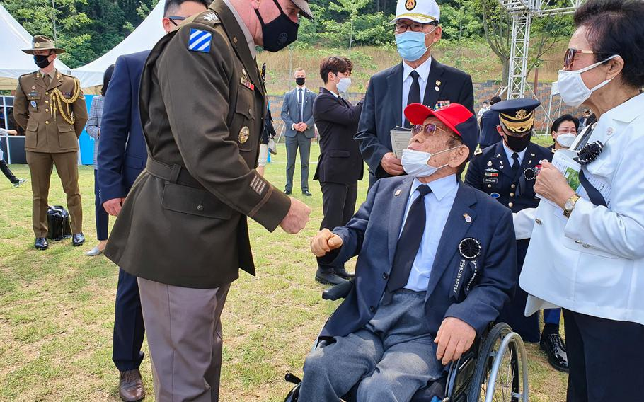 Retired South Korean general Yoon Seung-kook, who served with U.S. troops in Task Force Smith during the Korean War, is greeted by Gen. Robert Abrams, commander of U.S. Force Korea and United Nations Command, during a service at Osan Jukmiryeong Peace Park in Osan, South Korea, Sunday, July 5, 2020.