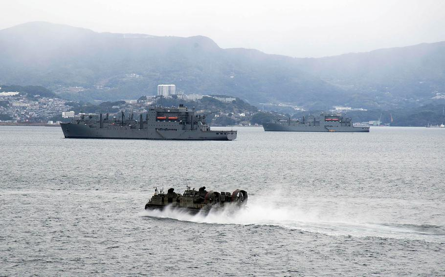 An air-cushioned landing craft makes its way across Sasebo Bay to dry cargo and ammunition ships on Feb. 16, 2016.