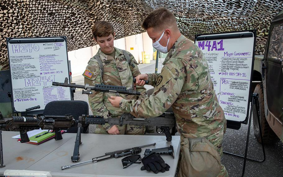 A soldier with the 25th Infantry Division assembles an M240 at Schofield Barracks, Hawaii, June 25, 2020, during preparation for the Lightning Forge exercise that runs through July 21.