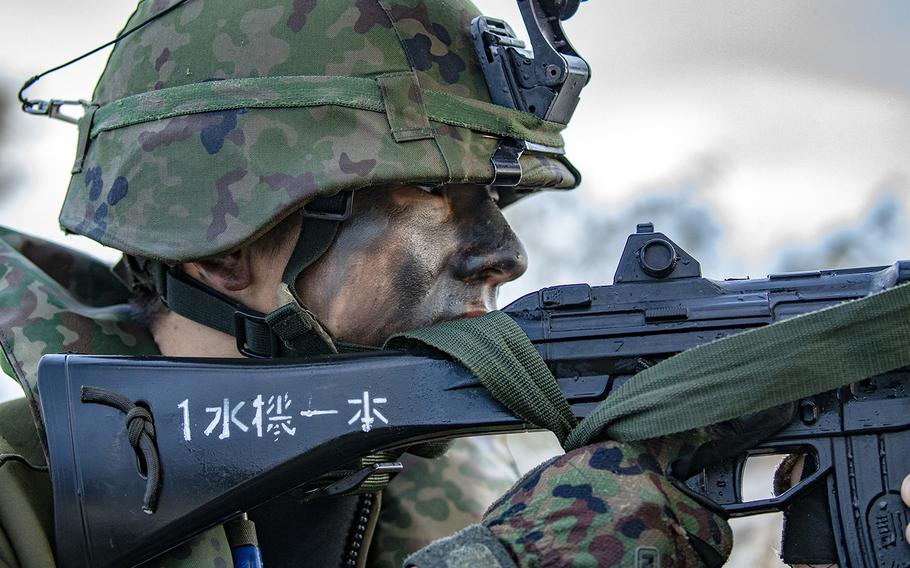 A member with the Japan Ground Self-Defense Force holds security during the Talisman Sabre exercise in Bowen, Australia, July 21, 2019.