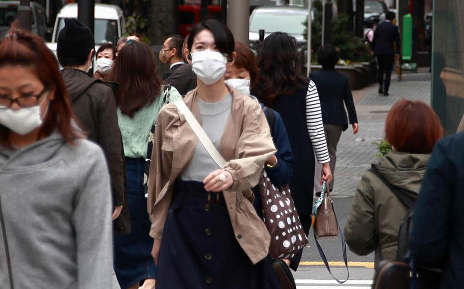 Pedestrians stroll through the Ometesando area of central Tokyo, May 22, 2020.