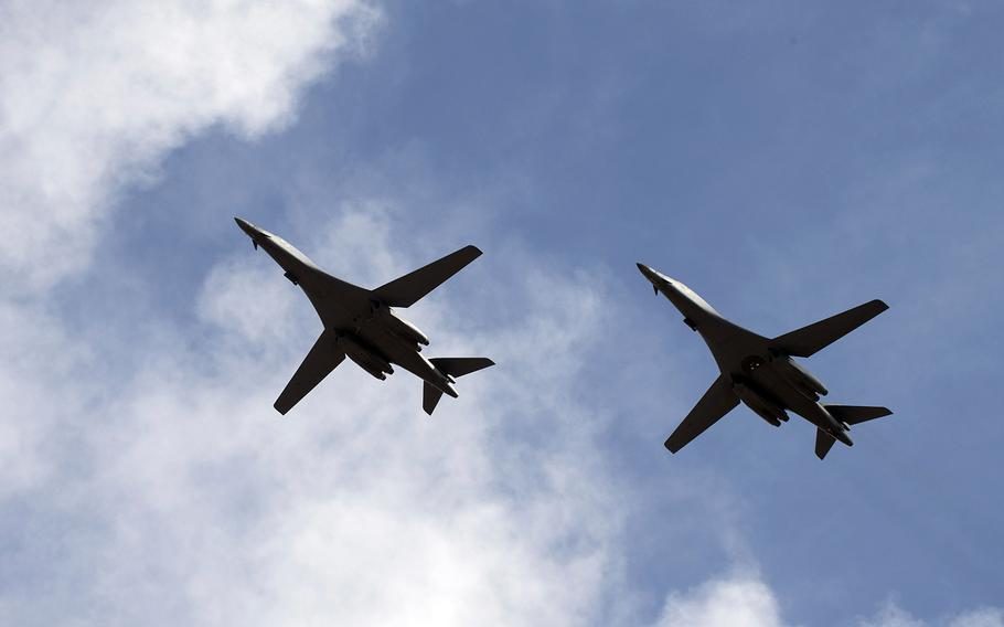 Two B-1B Lancers conduct a flyover before landing at Andersen Air Force Base, Guam, July 17, 2020.