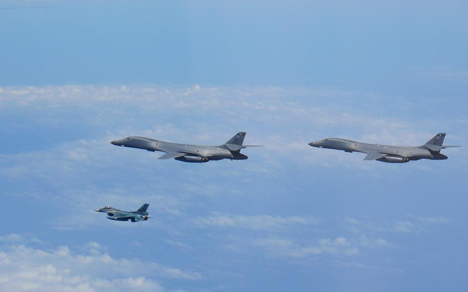 Two Air Force B-1B Lancers fly with a Japan Air Self-Defense Force F-2 fighter jet over the East China Sea, July 7, 2020.