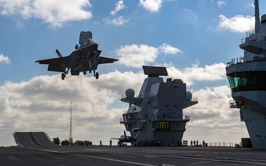 An F-35 Lightning II fighter lands on the HMS Queen Elizabeth in the North Atlantic on Nov. 16, 2018.