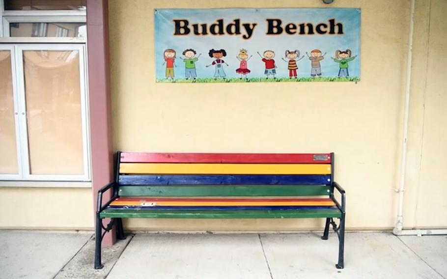 An empty buddy bench sits outside Daegu Elementary School, South Korea, in this screenshot from a video released by American Forces Network on May 28, 2020.