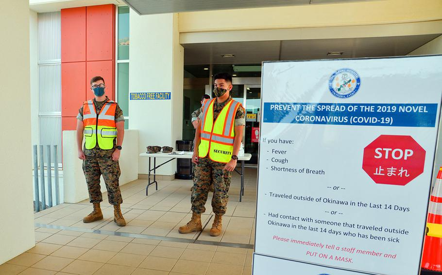 Marines wait to screen U.S. Naval Hospital Okinawa patients for the coronavirus in this photo posted to the hospital's Facebook page on July 15, 2020.