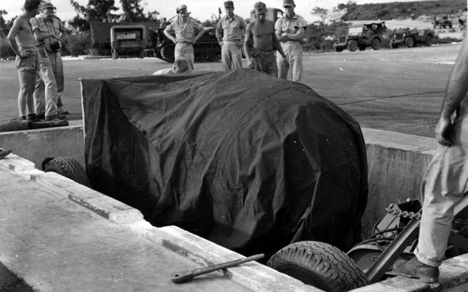 U.S. soldiers on Tinian prepare to load the Fat Man bomb for the atomic bombing mission to Nagasaki, Japan, on Aug. 9, 1945.