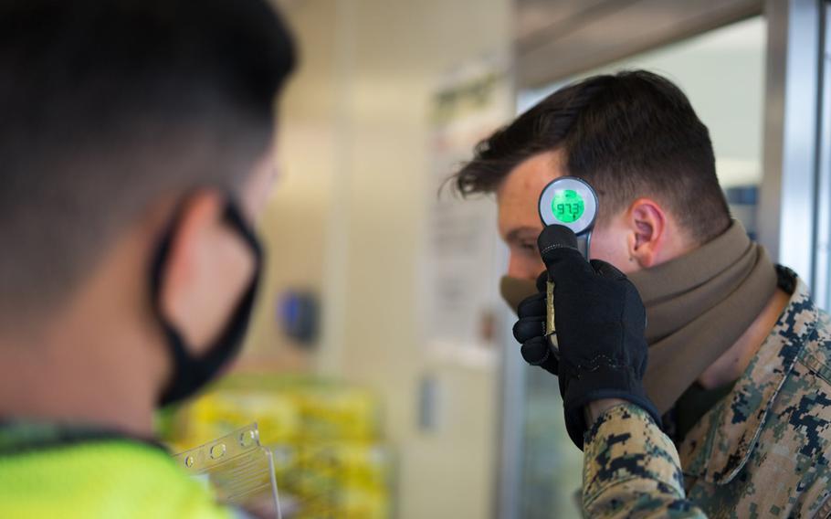 A Marine goes through a coronavirus screening at Camp Courtney, Okinawa, July 13, 2020.