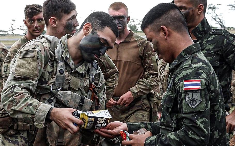 Soldiers with the 25th Infantry Division and Royal Thai Army mix during the Lightning Forge exercise in Hawaii, July 12, 2020.