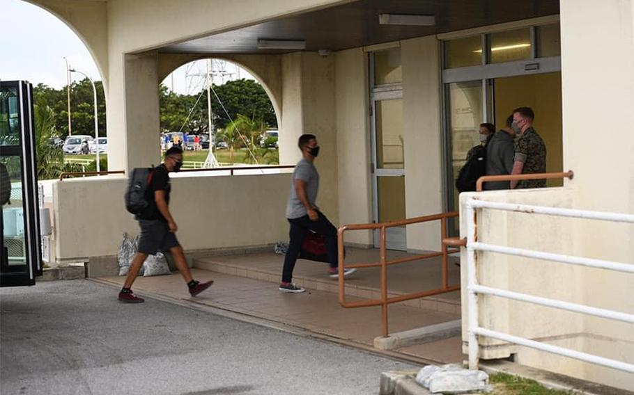 U.S. service members new to Okinawa arrive at Kadena Air Base in this photo posted to the 18th Wing's Facebook page on July 27, 2020. All were moved into 14 days of restriction of movement and will be tested for coronavirus before being released.