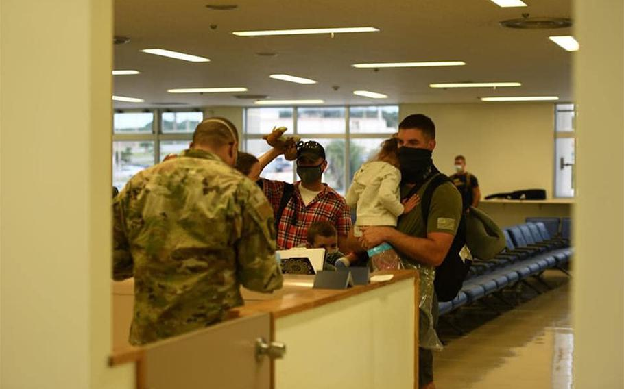 U.S. personnel new to Okinawa arrive at Kadena Air Base in this photo posted to the 18th Wing's Facebook page on July 27, 2020. All were moved into 14 days of restriction of movement and will be tested for coronavirus before being released.