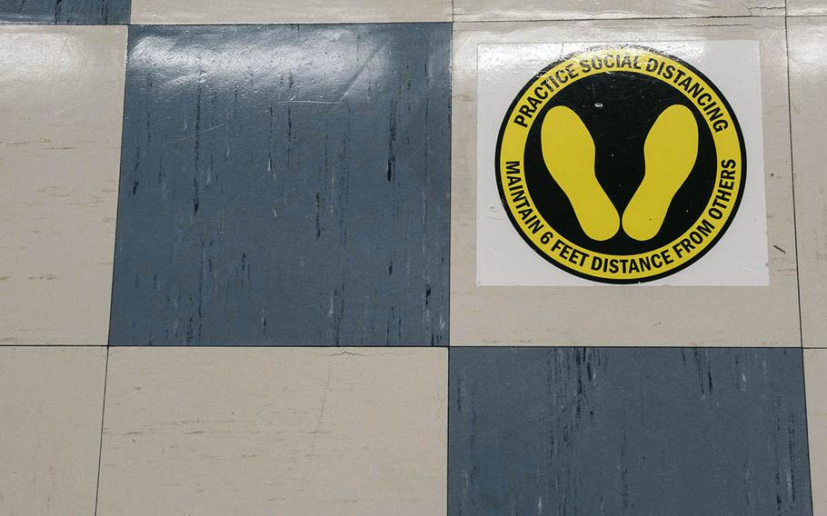 A floor decal encourages social distancing at the home of U.S. Forces Japan in western Tokyo, Wednesday, July 29, 2020.