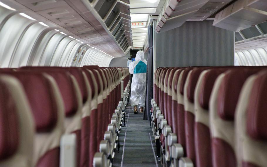 A sanitation crew works to disinfect the Patriot Express at Osan Air Base, South Korea, July 14, 2020.