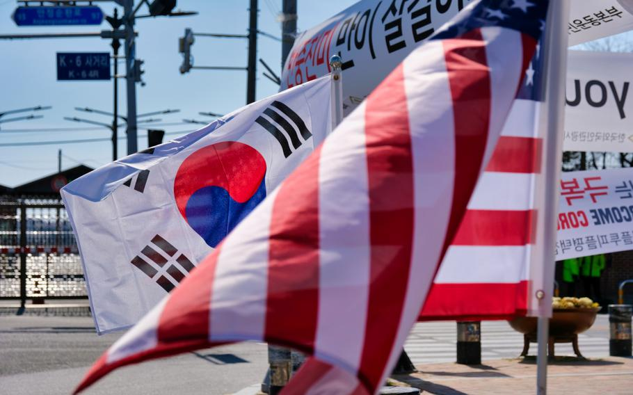 American and South Korean flags are displayed together outside Camp Humphreys, South Korea, March 16, 2020.
