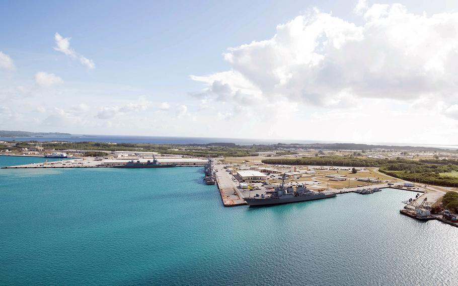 This aerial view of U.S. Naval Base Guam shows several Navy vessels moored in Apra Harbor, March 15, 2018.