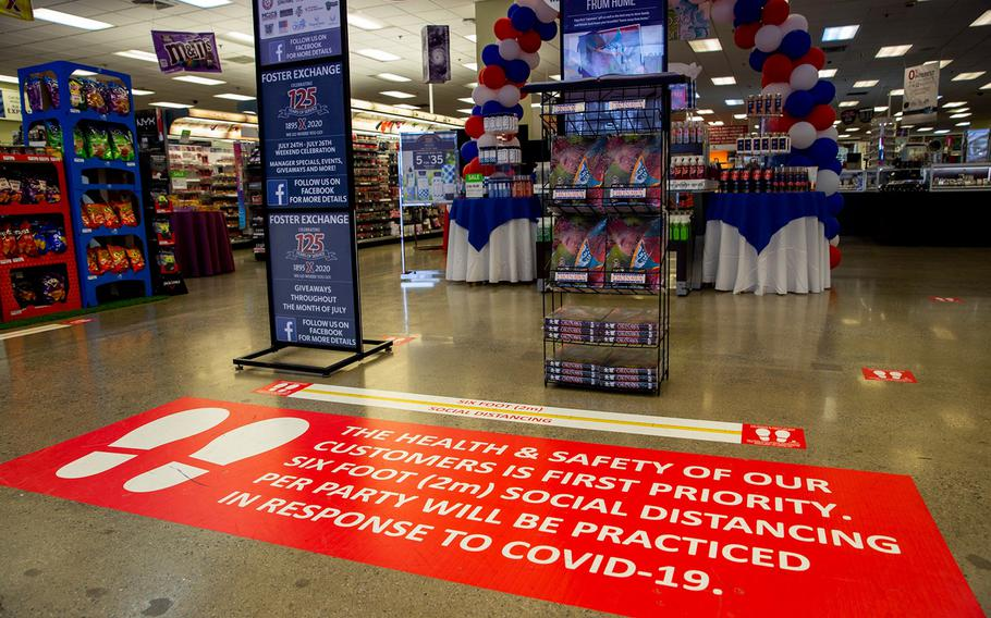 Floor decals urge exchange shoppers to practice social distancing at Camp Foster, Okinawa, July 29, 2020.