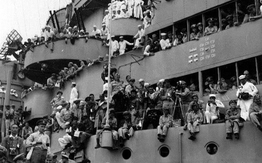 American troops cram aboard the USS Missouri on Sept. 2, 1945, to witness the official surrender of Japan that ended World War II.