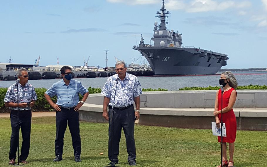 Members of the 75th World War II Commemoration Committee talk with reporters at the Pearl Harbor Visitors Center, Hawaii, Wednesday, Aug. 5, 2020.