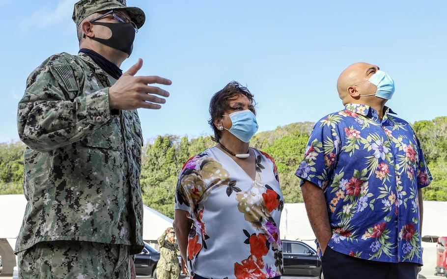 Guam Gov. Lou Leon Guerrero, center, and Lt. Gov. Josh Tenorio, right, check out the USS Theodore Roosevelt with Rear Adm. John Menoni, commander of Joint Region Marianas, at Naval Base Guam, May 21, 2020.