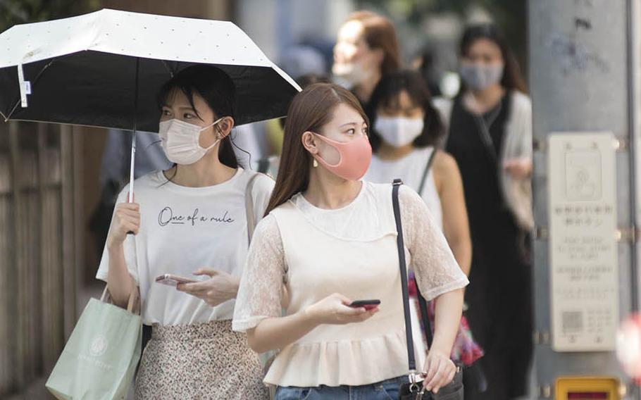 Pedestrians guard against the coronavirus in the Omotesando district of central Tokyo, Friday, Aug. 14, 2020. Akifumi Ishikawa/Stars and Stripes