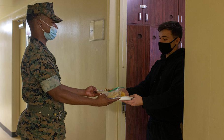A Marine delivers food to a quarantined Marine on Camp Courtney, Okinawa, Japan, Aug. 16, 2020.