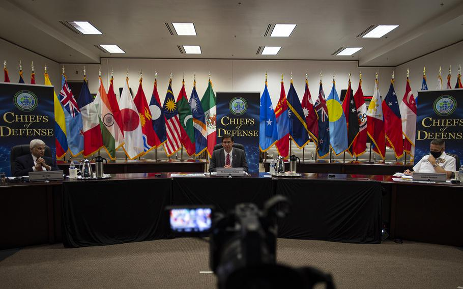 Moderator Ashley Tellis, from left, Defense Secretary Mark Esper and Indo-Pacific Command commander Adm. Phil Davidson participate in the Indo-Pacific Chiefs of Defense Conference, Tuesday, Aug. 25, 2020.