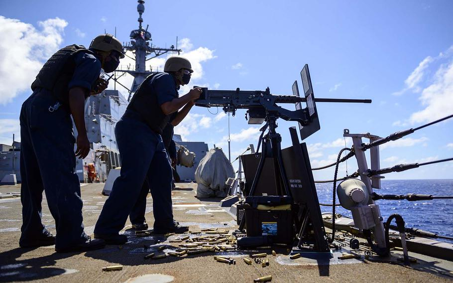 A sailor fires a .50-caliber machine gun aboard the guided-missile destroyer USS Chung-Hoon during the Rim of the Pacific exercise Aug. 19, 2020, in waters near the Hawaiian Islands.