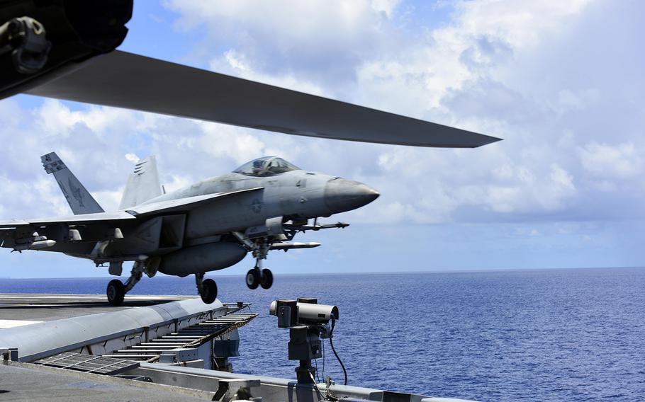 An F/A-18E from Strike Fighter Squadron 195 takes off from the aircraft carrier USS Ronald Reagan in the South China Sea, Aug. 14, 2020.