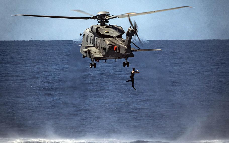 A diver from the Royal Canadian Navy ship HMCS Regina jumps into the Pacific Ocean as part of a diver training flight Aug. 22, 2020, during the Rim of the Pacific exercise near Hawaii. Royal Canadian Navy