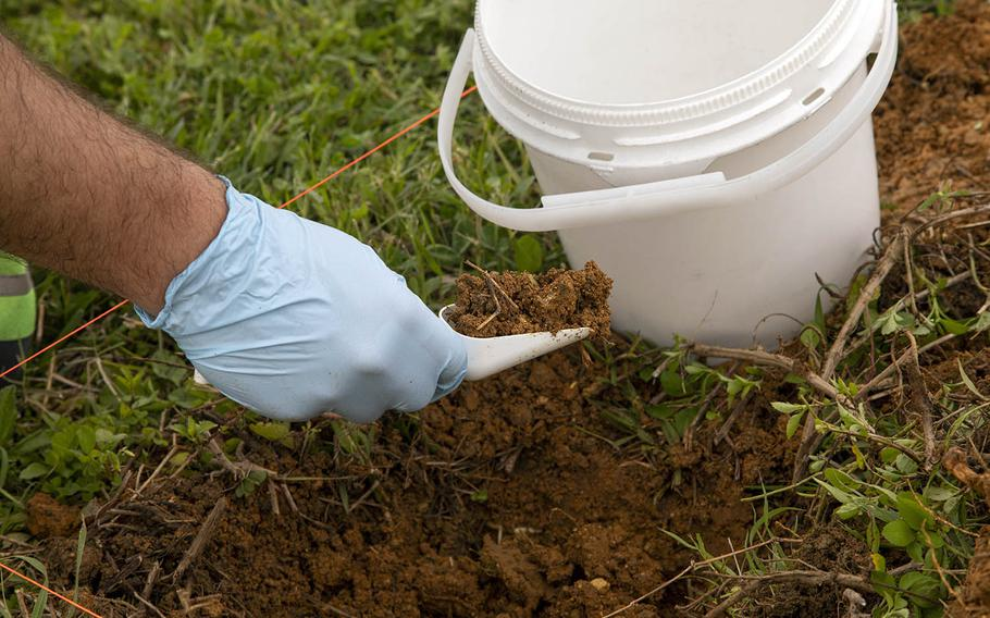 Soil samples are taken at Marine Corps Air Station Futenma, Okinawa, May 11, 2020, following a firefighting foam spill that happened a month earlier.