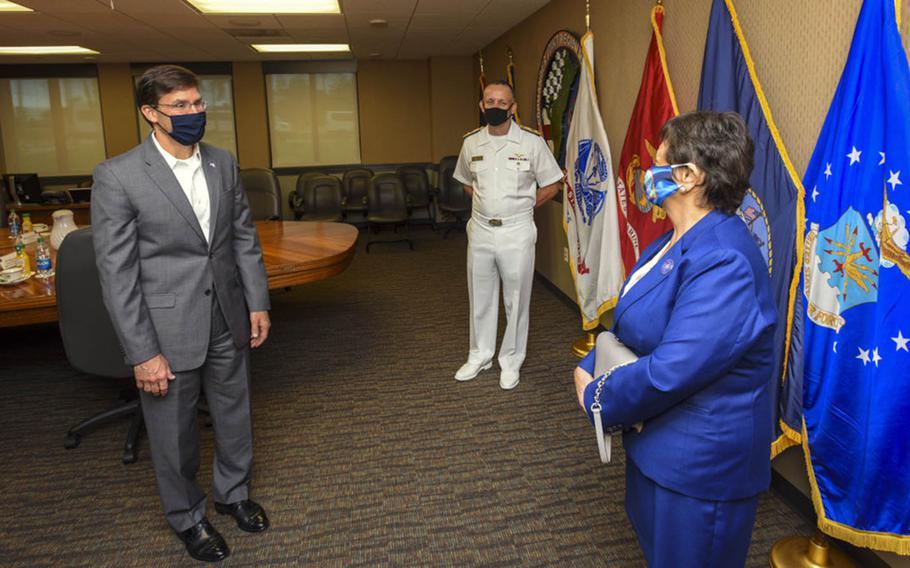 Defense Secretary Mark  Esper, left, and Rear Adm. John Menoni, commander of Joint Region Marianas, meet with Guam Gov. Lou Leon Guerrero in Asan, Guam, Aug. 29, 2020.