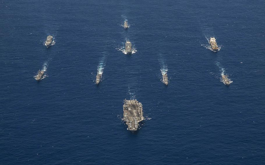 The aircraft carrier USS Ronald Reagan leads its strike group in the Philippine Sea during Valiant Shield 2018.
