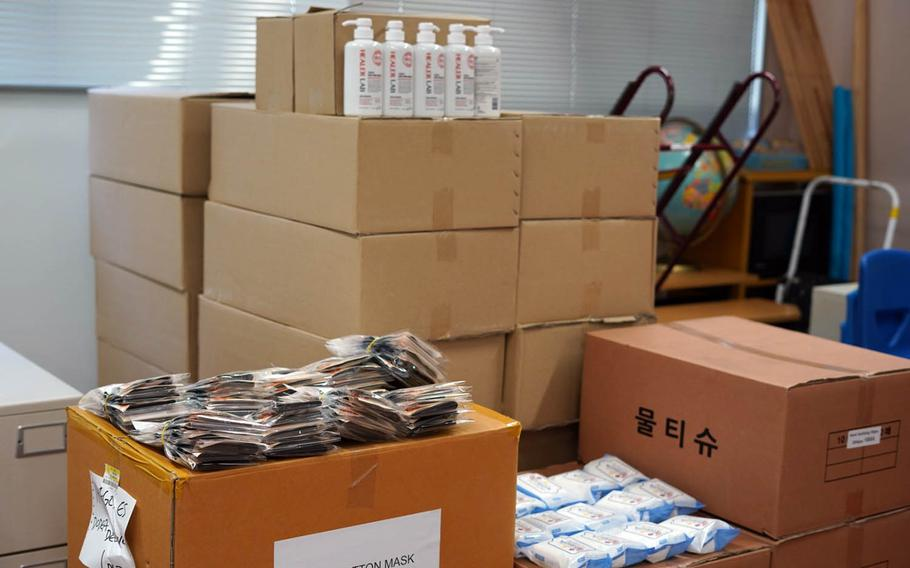 Boxes of hand sanitizer, cleaning wipes, face masks and other supplies are stored for student use at Ikego Elementary School, Japan. Aug. 24, 2020.