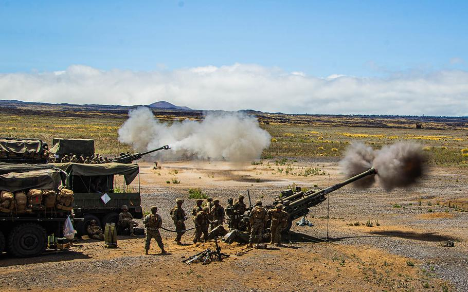 Marines with Battery C, 1st Battalion, 12th Marine Regiment, fire M777 Howitzer rounds at Pohakuloa Training Area, Hawaii, July 21, 2020.