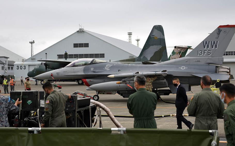 An Air Force F-16C Fighting Falcon is refueled by a Japan Air Self-Defense Force aircraft during training at Chitose Air Base in Hokkaido, Japan. Aug. 25, 2020.
