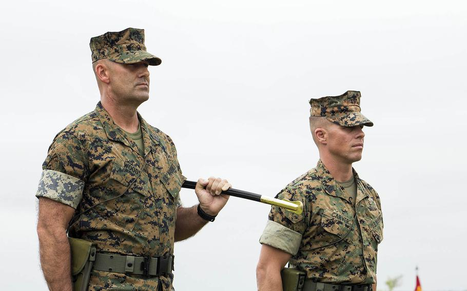 Marine Corps Sgt. Maj. Michael P. Woods, left, seen here in 2016 at Camp Lejeune, N.C., took over as sergeant major for III Marine Expeditionary Force on Okinawa, Aug. 4, 2020.