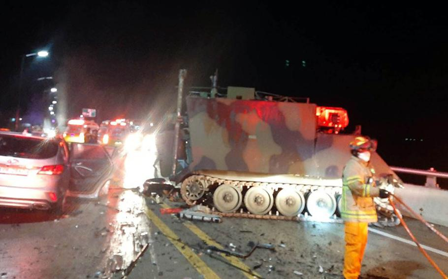 Emergency workers tend to the scene after a collision involving a U.S. armored personnel carrier and a civilian SUV that killed four South Koreans near the Rodriguez Live-Fire Complex in Pocheon, South Korea, Aug. 30, 2020.