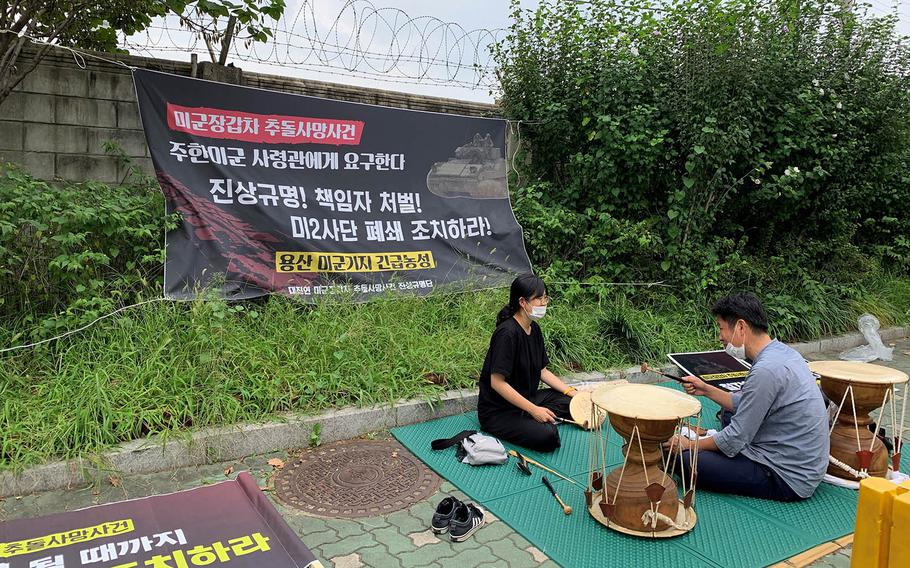 Members of the Progressive Korea University Student Association call for answers on the U.S. military's involvement in a fatal car crash during a sit-in outside Yongsan Garrison in Seoul, South Korea, Sept. 14, 2020.