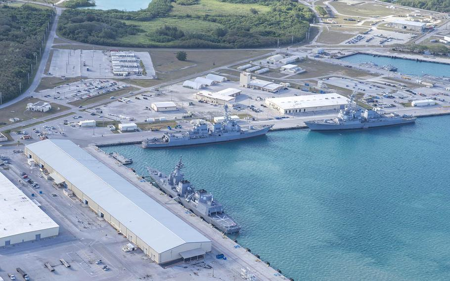 This aerial view of Naval Base Guam shows several Navy vessels moored at Apra Harbor, March 15, 2018.