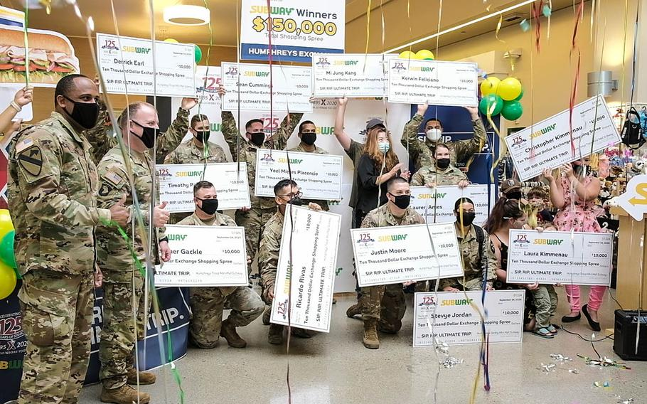 Fifteen winners of a $10,000 shopping spree celebrate at the post exchange on Camp Humphreys, South Korea, Thursday, Sept. 24, 2020.