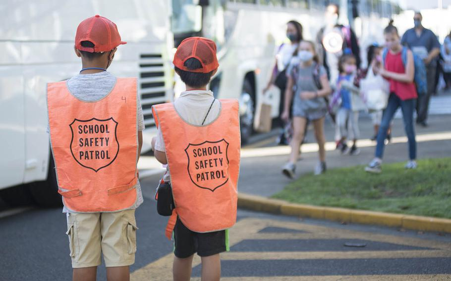Safety patrol members look after their fellow Sullivans Elementary School students on the first day of in-person classes at Yokosuka Naval Base, Japan, Monday, Sept. 28, 2020.