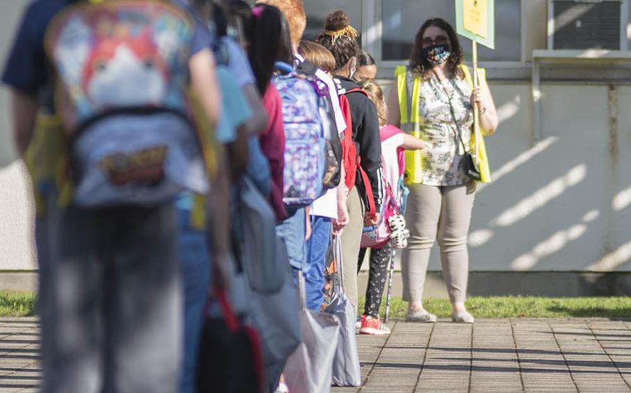 Sullivans Elementary School students line up for their first day of in-person classes at Yokosuka Naval Base, Japan, Monday, Sept. 28, 2020.