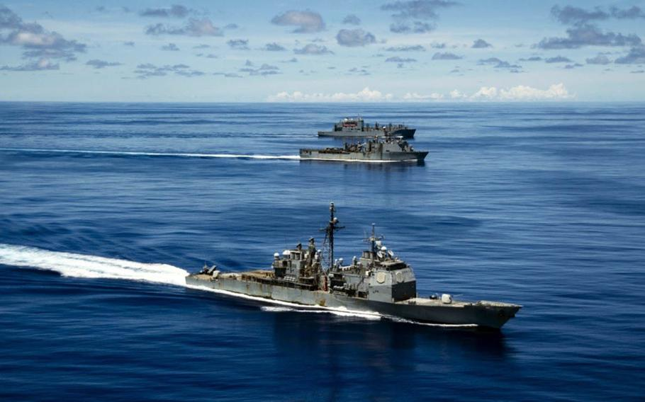 The USS Antietam, front, sails with the USS Germantown and USNS Sacagawea during the Valient Shield exercise near Guam, Sept. 25, 2020. A small fire broke out on the Antietam the day before.