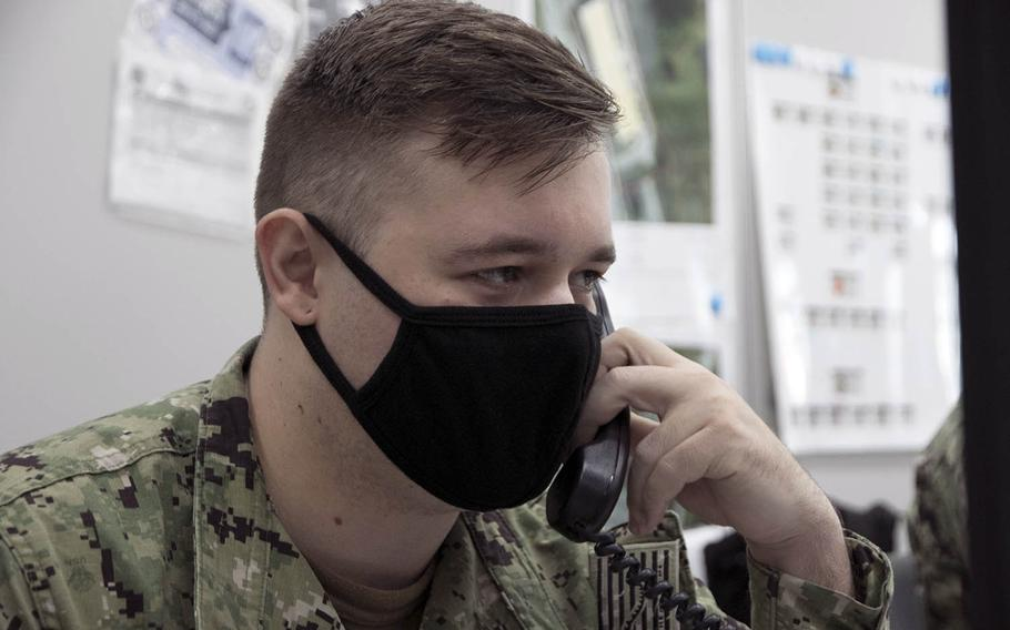 Seaman Justin Funder, 25, a hospitalman from St. Cloud, Minn., takes a call inside the COVID Cell at U.S. Naval Hospital Okinawa, Sept. 4, 2020.
