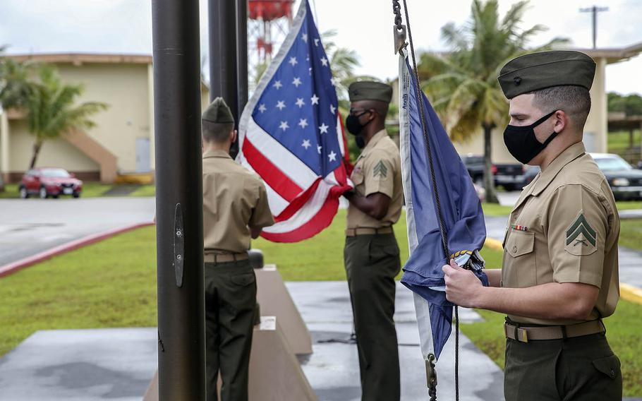 Marines raise flags for the first time at the new Camp Blaz on Guam, Thursday, Oct. 1, 2020.