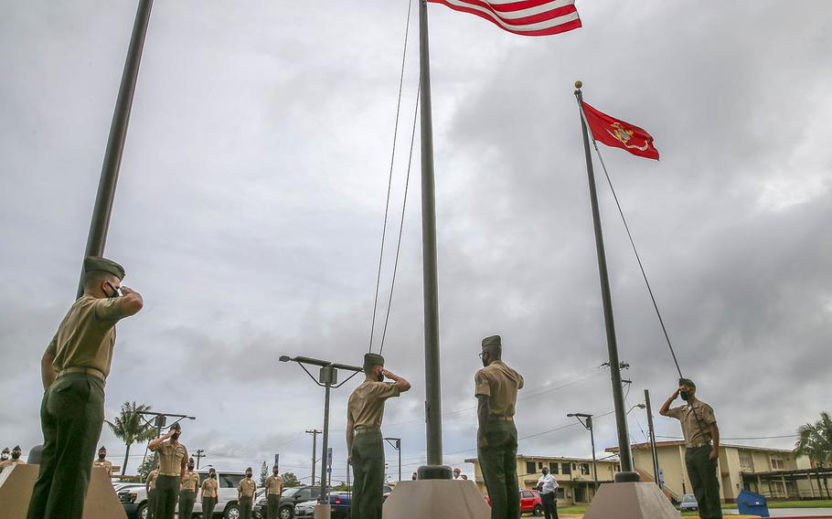 Marines salue after raising flags for the first time at the new Camp Blaz on Guam, Thursday, Oct. 1, 2020.