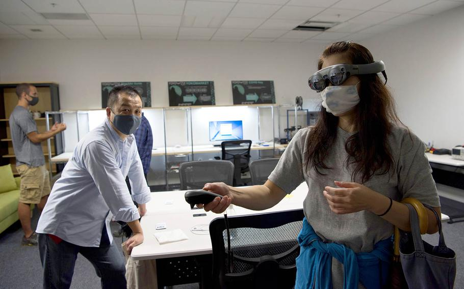 Kayoko Seta, 374th Contracting Squadron contracting specialist, experiences augmented reality for the first time in the newly-opened YokoWerx innovation lab at Yokota Air Base, Japan, Sept. 25, 2020.