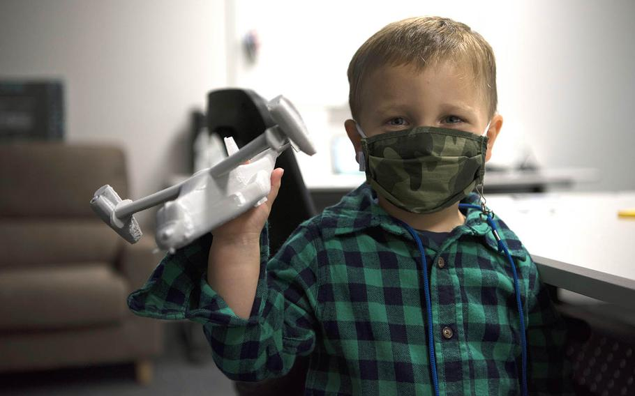 Finley Wilson, son of Master Sgt. Daniel Wilson, 5th Air Force intelligence, surveillance, reconnaissance and cyber effects operations superintendent, plays with a 3D printed CV-22 Osprey in the newly-opened YokoWerx innovation lab at Yokota Air Base, Japan, Sept. 25, 2020.